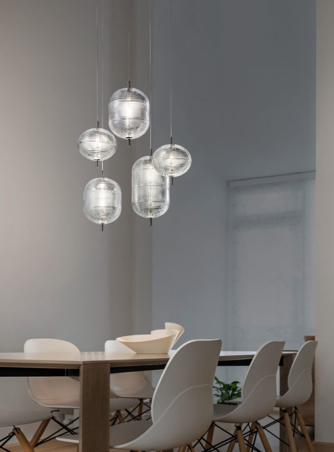 Jefferson Pendant Light by Studio Italia Design suspended over dining table