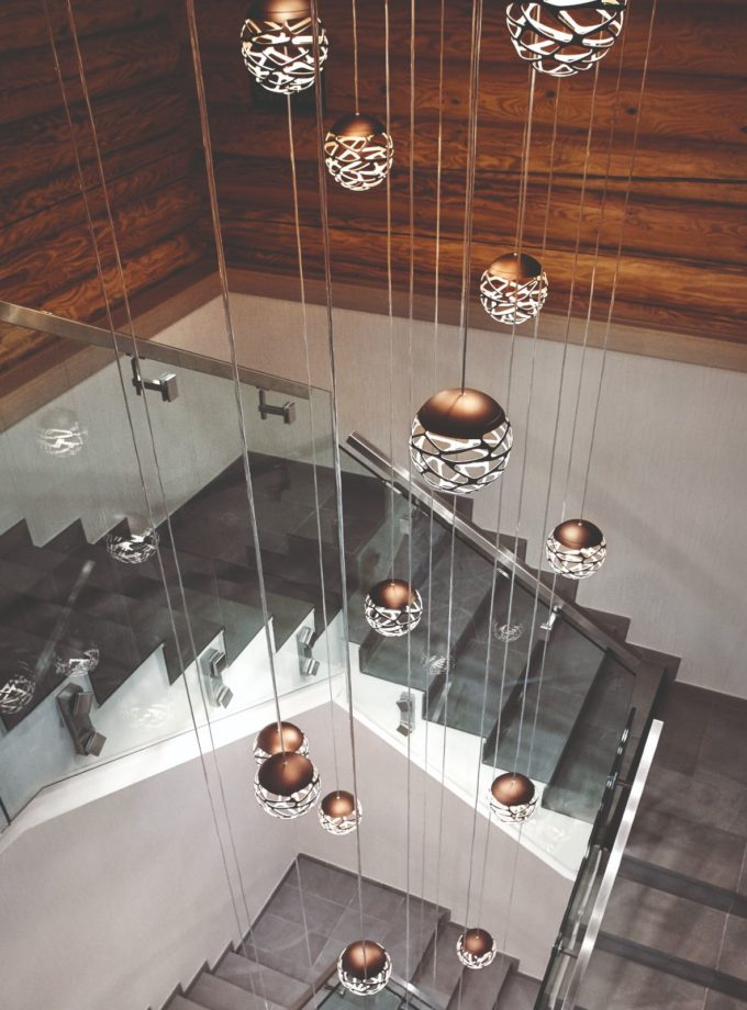 Kelly Cluster Pendant Light by Studio Italia Design hanging in a stairwell