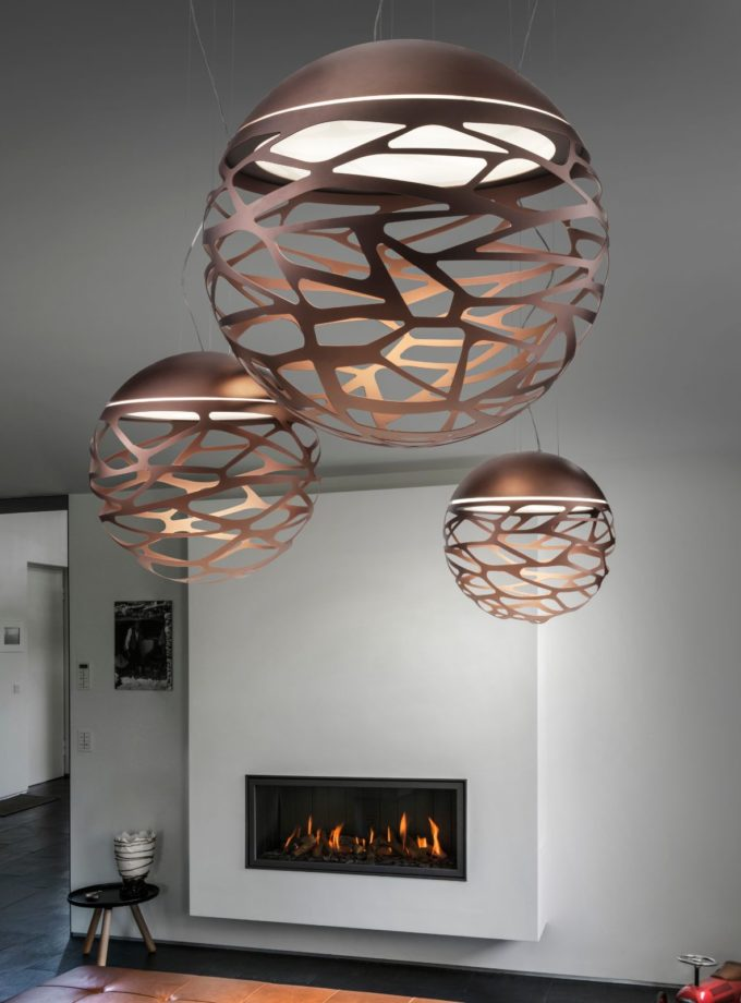 Kelly Sphere Pendant Lights by Studio Italia Design hanging in a living room near a fireplace